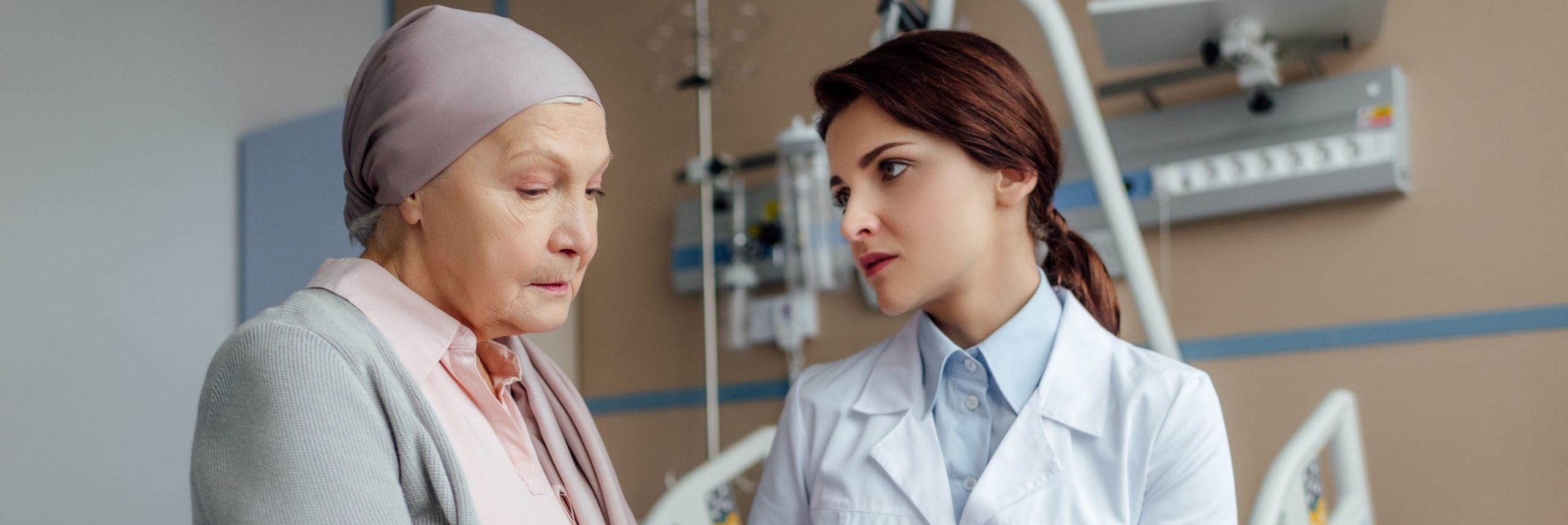 crello-234261180-stock-photo-worried-female-doctor-holding-hands (1)
